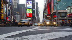 Street-level view of traffic approaching on 7th Avenue near Times Square Stock Footage