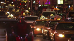 Varied evening traffic approaching camera on street near Times Square - stock footage