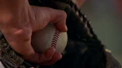 Close-up of ball in glove of left-handed pitcher - stock footage
