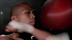 Close-up face of boxer doing speed work on a punching bag Stock Footage