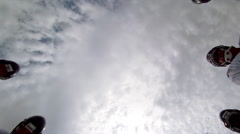 Looking up from ground at center of a football huddle Stock Footage