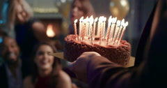 Beautiful woman shares birthday celebration with sexy friends Stock Footage