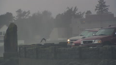 Cars parked behind seawall at storm-watching viewpoint in Depoe Bay, Oregon - stock footage