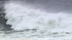Frame-filling stormy wave cresting and subsiding into foam Stock Footage