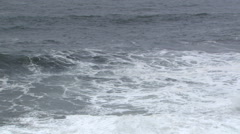 Incoming waves meeting back-surge of surf and bounding upward - stock footage
