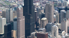 Aerial view zooming out from downtown Chicago to suburbs - stock footage