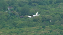 Small plane in flight seen from above Stock Footage