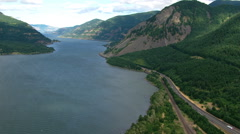 Fast flight through Columbia River Gorge in Oregon Stock Footage