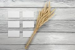 Wheat Ears on Wooden Table with blank business cards. Harvest concept - stock photo