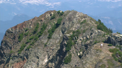 Orbiting rugged granite peak in Cascade Range. Shot in 2003. Stock Footage