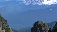 Flight among mountain peaks in British Columbia. Shot in 2003. Stock Footage