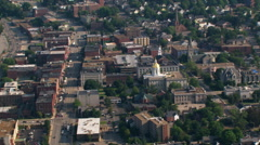 Flight over capitol building and neighborhood in Concord, NH Stock Footage