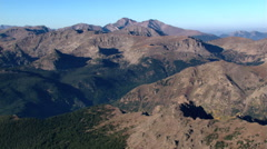 Wide aerial view of barren, brown mountains in Colorado. Shot in 2003. - stock footage