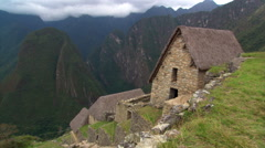 Machu Picchu, Peru: Pan from thatched roofs to Eastern Urban Center Stock Footage