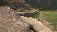 Machu Picchu, Peru: Aqueduct, dry moat and housing area Stock Footage