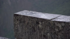 Machu Picchu, Peru: close-up of rain splattering on a stone wall - stock footage