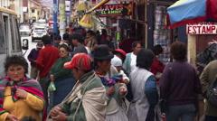 Busy street and crowded sidewalk in Cusco, Peru Stock Footage