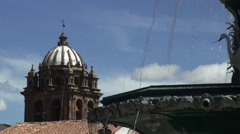Fountain and Church of La Compania in the Plaza de Armas in Cusco, Peru - stock footage