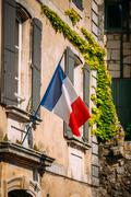 French Tricolours National Flag Decorate Building In France - stock photo