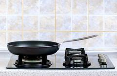 frying pan on the gas stove - stock photo
