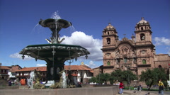Fountain in the Plaza de Armas and the Church of La Compania in Cusco, Peru Stock Footage