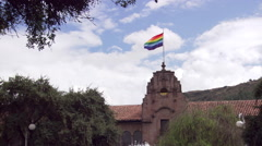 Zoom-out from flag to plaza in Cusco, Peru Stock Footage