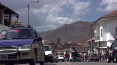Street-level view of traffic and pedestrians in Cusco, Peru Stock Footage
