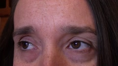 Tired eyes of woman in her 40th Stock Footage