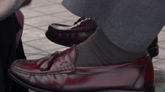 Close-up of shoes tilting up to shoeshine girl in Cayambe, Ecuador Stock Footage