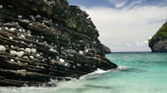 Black rocks at the Nui Bay, Phi Phi Don island, Krabi, Thailand. Stock Footage