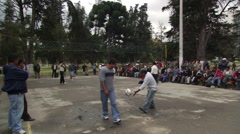 Men's volleyball game in a park in Quito, Ecuador Stock Footage