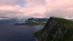 Flying in clouds by the cliffs on Lofoten islands, Norway Stock Footage