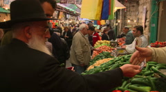Shoppers choosing vegetables at an Israeli produce market Stock Footage