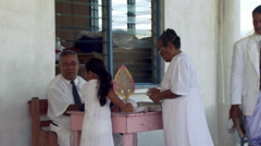 Congregation entering a church in Polynesia - stock footage