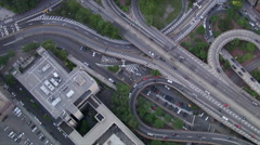 Flying above a highway interchange and over City Hall in New York City Stock Footage
