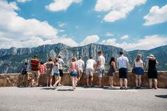 People look at mountains from lookout in Gorges Du Verdon in sou - stock photo