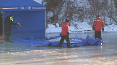 Stock Video Footage of Police officers recover body of missing woman found in pond ice