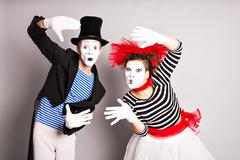 Stock Photo of Waist-up portrait of funny mime couple with white faces. April Fools' Day -
