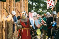 Historical restoration of knightly fights. The siege of wooden f Stock Photos