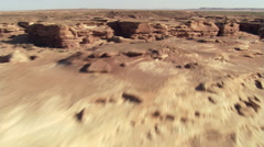 Low, fast flight over Painted Desert in Arizona Stock Footage