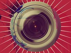 Camera lens on red background - stock illustration
