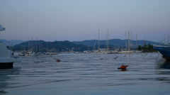 Group of sailing ships in the La Spezia harbor at evening, Laguria, Italy Stock Footage