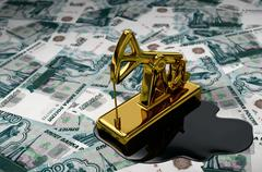 Golden Pumpjack And Spilled Oil On Russian Rubles Stock Photos