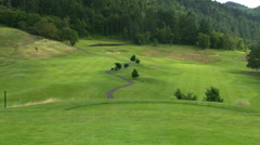 Cart paths and golf course viewed from hill top tee blocks Stock Footage