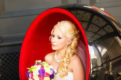 Portrait of beautiful bride with wedding bouquet Stock Photos