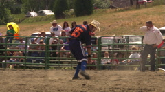 Rodeo clown in football jersey entertaining spectators with amusing dance Stock Footage