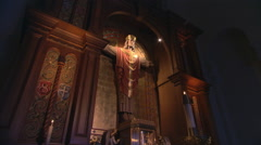 Crucifix with Christ crowned hanging in elaborately carved alcove - stock footage