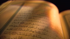 Close view of open Quran with tilt to top of page Stock Footage