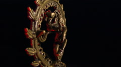 Encircled golden image of Shiva with red highlights rotating on black frame - stock footage