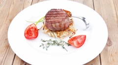 Grilled beef fillet pieces on noodles with tomatoes and dry spic Stock Footage